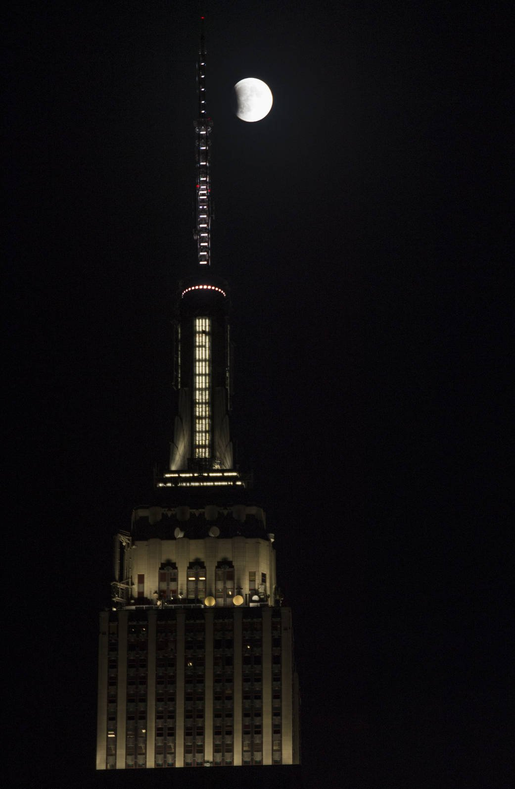 A perigee full moon, or supermoon, is seen next to the Empire State Building at the beginning of a total lunar eclipse, Sunday, Sept. 27, 2015 in New York City. The combination of a supermoon and total lunar eclipse last occurred in 1982 and will not happen again until 2033. Photo Credit: (NASA/Joel Kowsky)